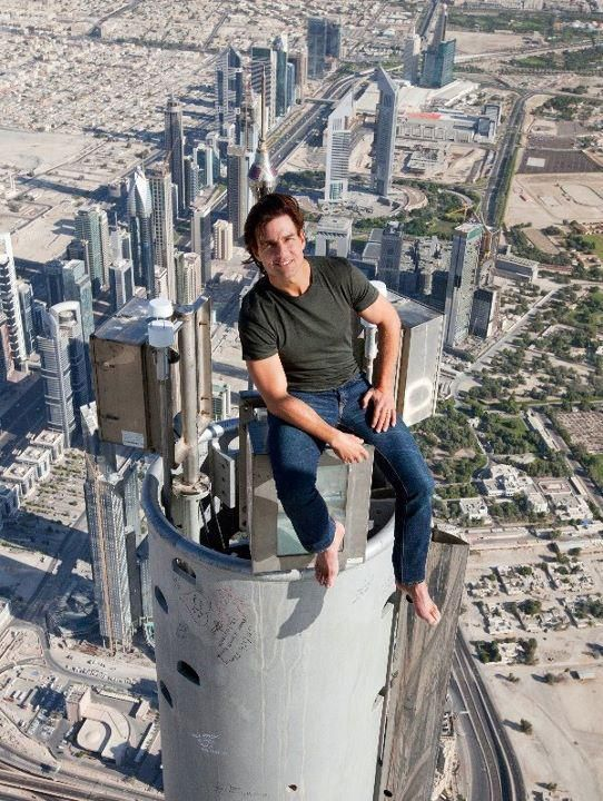 Tom Cruise sitting on the very top of the Burj Khalifa in Dubai during the filming of Mission Impossible 4. I wish someday I get a chance to sit there and get to relish the breathtaking view.